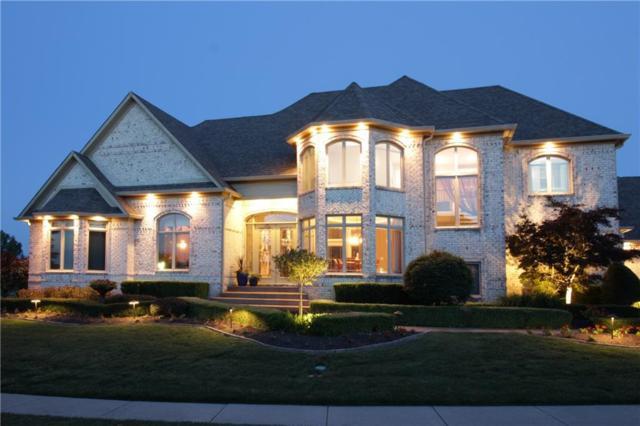 4509 Heatherwood Boulevard, Greenwood, IN 46143 (MLS #21574775) :: The Indy Property Source
