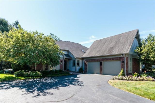 9327 Spring Lakes Drive, Indianapolis, IN 46260 (MLS #21582781) :: FC Tucker Company