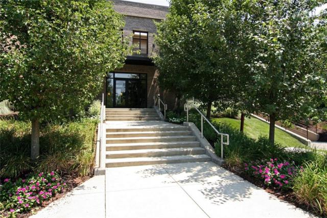 8555 One West Drive #104, Indianapolis, IN 46260 (MLS #21584305) :: AR/haus Group Realty