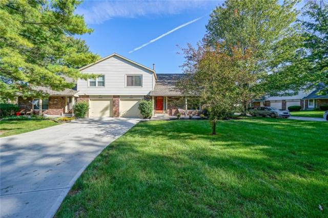 8980 Cinnebar Drive, Indianapolis, IN 46268 (MLS #21598956) :: Mike Price Realty Team - RE/MAX Centerstone