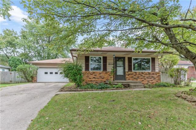 10303 Baribeau Lane, Indianapolis, IN 46229 (MLS #21599806) :: Mike Price Realty Team - RE/MAX Centerstone