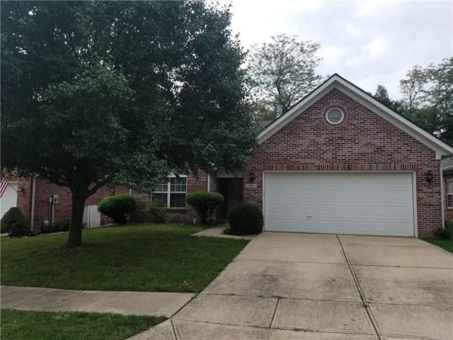 9647 E Woodsong Way, Indianapolis, IN 46229 (MLS #21599883) :: Richwine Elite Group