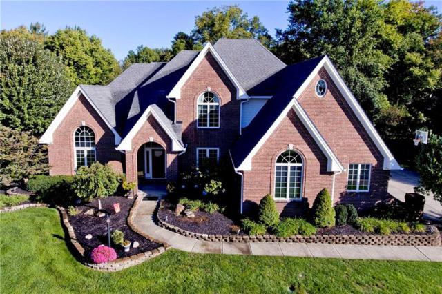 4976 Deer Ridge Drive N, Carmel, IN 46033 (MLS #21599996) :: Richwine Elite Group