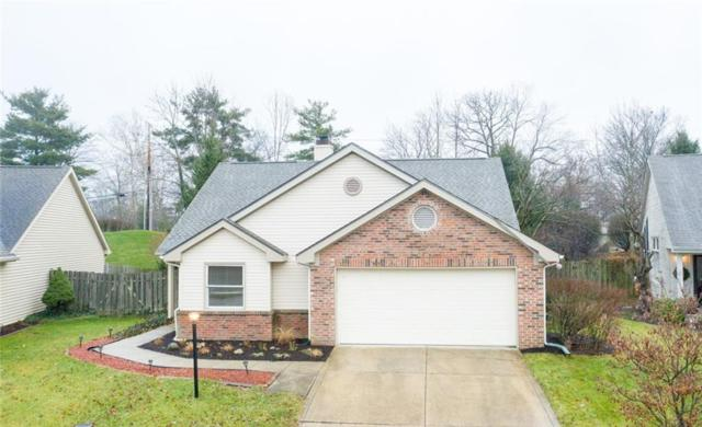 8633 Champions Drive, Indianapolis, IN 46256 (MLS #21611085) :: Richwine Elite Group