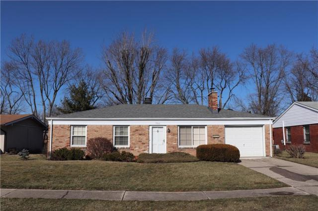 7906 Gilmore Road, Indianapolis, IN 46219 (MLS #21617222) :: The ORR Home Selling Team