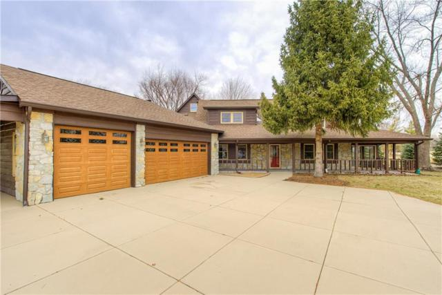 9644 Greentree Drive, Carmel, IN 46032 (MLS #21618892) :: The Evelo Team