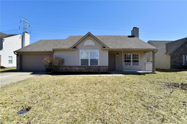 6061 Peregrine Boulevard, Indianapolis, IN 46228 (MLS #21628680) :: The Evelo Team