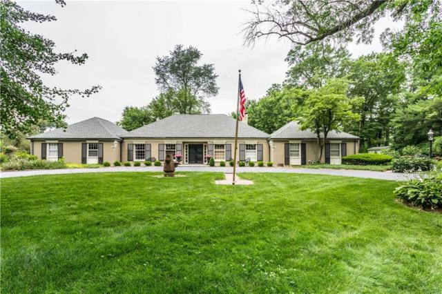 9590 Copley Drive, Indianapolis, IN 46260 (MLS #21646096) :: Richwine Elite Group