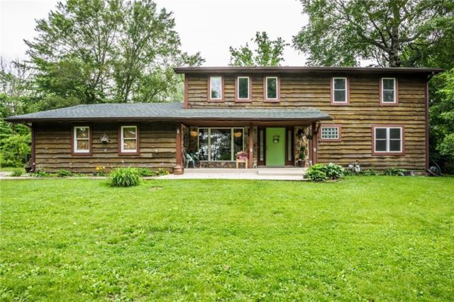 7714 E 250 N, Greenfield, IN 46140 (MLS #21646512) :: AR/haus Group Realty