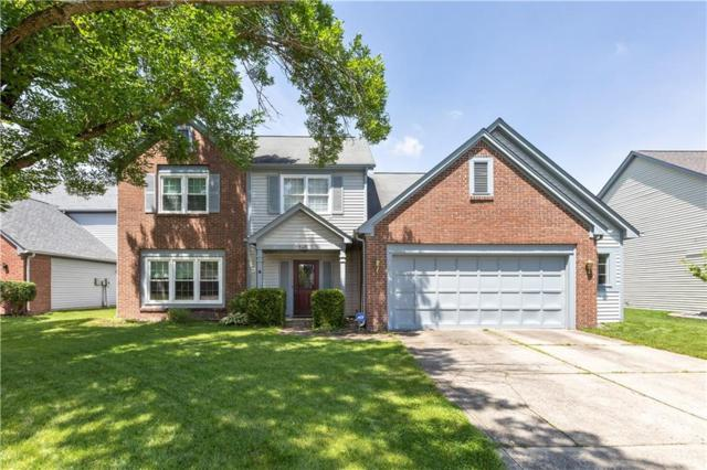 8642 Ray Circle, Indianapolis, IN 46256 (MLS #21649877) :: Richwine Elite Group