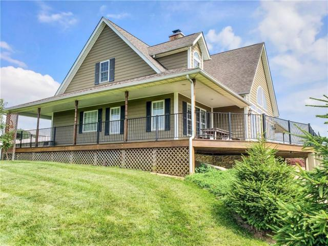 9157 Oxford Pike, Brookville, IN 47012 (MLS #21650462) :: HergGroup Indianapolis