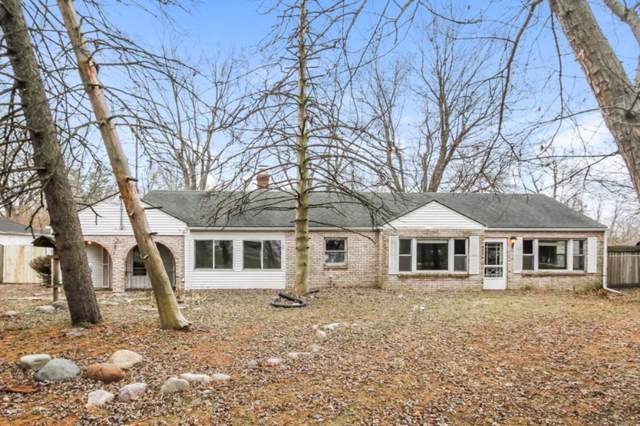 9825 E 21st Street, Indianapolis, IN 46229 (MLS #21685158) :: The Indy Property Source