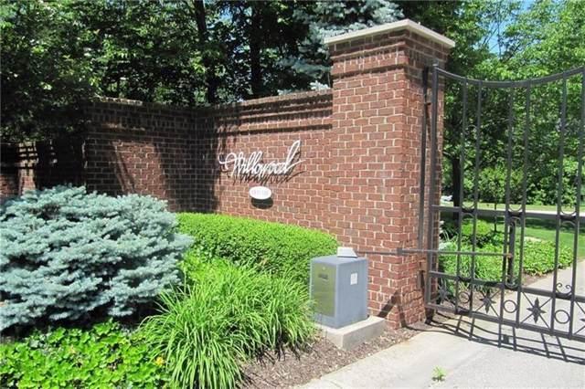 9151 Willowrun Drive, Indianapolis, IN 46260 (MLS #21685859) :: David Brenton's Team