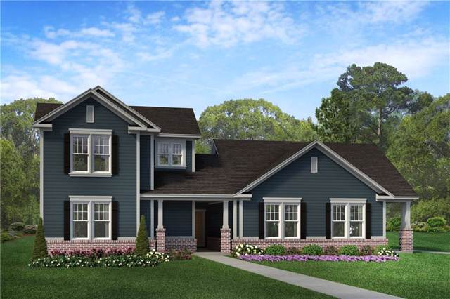 7116 Cherry Creek Blvd, Carmel, IN 46033 (MLS #21686111) :: AR/haus Group Realty