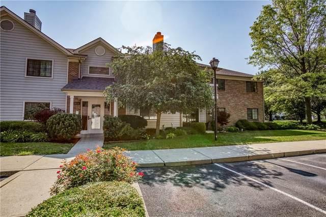 11715 Lenox Lane #207, Carmel, IN 46032 (MLS #21723656) :: David Brenton's Team