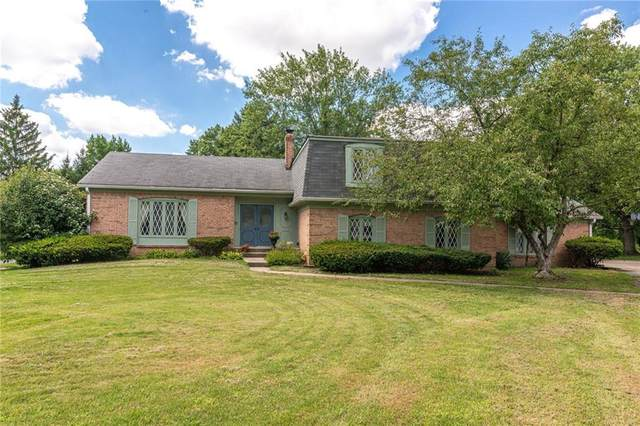1948 Huckleberry Court, Indianapolis, IN 46260 (MLS #21729889) :: Mike Price Realty Team - RE/MAX Centerstone