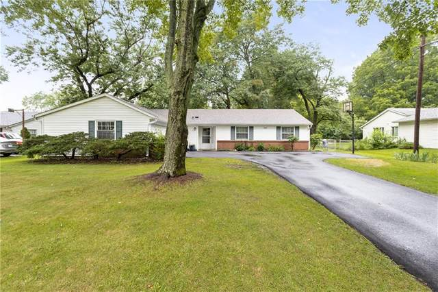 7040 Grandview Drive, Indianapolis, IN 46260 (MLS #21731073) :: Mike Price Realty Team - RE/MAX Centerstone
