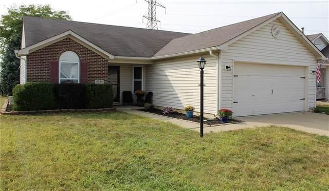 8034 Corktree Drive, Indianapolis, IN 46239 (MLS #21739373) :: Richwine Elite Group
