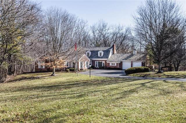 7767 Spring Mill Road, Indianapolis, IN 46260 (MLS #21768109) :: Mike Price Realty Team - RE/MAX Centerstone