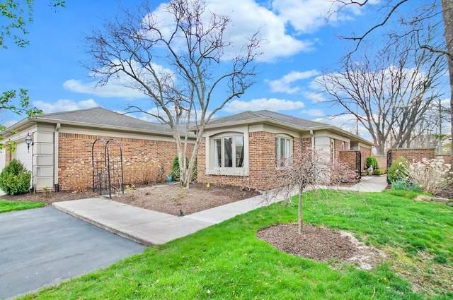 411 Bent Tree Lane, Indianapolis, IN 46260 (MLS #21769735) :: Heard Real Estate Team | eXp Realty, LLC