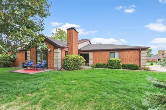 9299 Golden Oaks East, Indianapolis, IN 46260 (MLS #21774029) :: Mike Price Realty Team - RE/MAX Centerstone