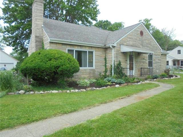 9719 E 10th Street, Indianapolis, IN 46229 (MLS #21790135) :: Mike Price Realty Team - RE/MAX Centerstone