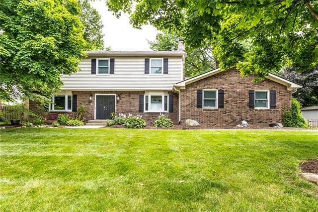 12009 Brookshire Pkwy, Carmel, IN 46033 (MLS #21799290) :: AR/haus Group Realty