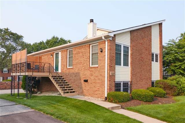 1227 Kings Cove Court, Indianapolis, IN 46260 (MLS #21801046) :: AR/haus Group Realty