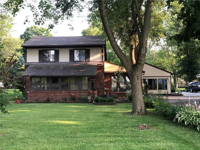8711 E 21st Street, Indianapolis, IN 46219 (MLS #21801398) :: Mike Price Realty Team - RE/MAX Centerstone
