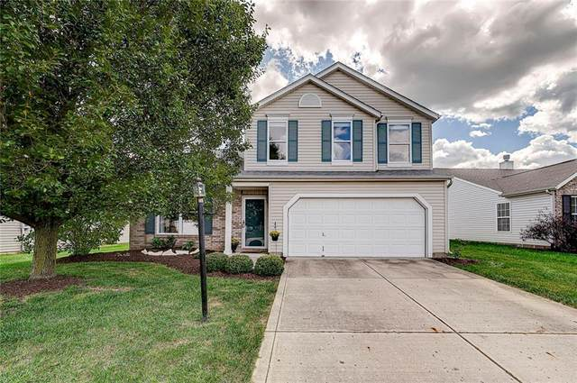 12213 Carriage Stone Drive, Fishers, IN 46037 (MLS #21810916) :: Richwine Elite Group