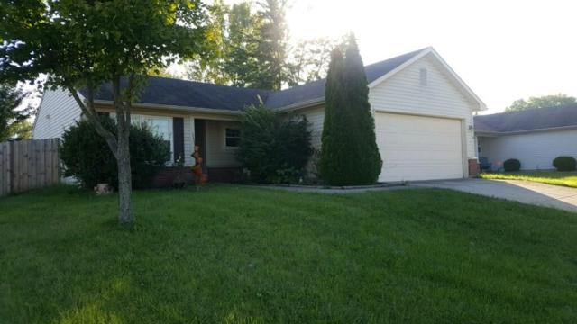 6142 Rocky River Drive, Indianapolis, IN 46221 (MLS #21595390) :: The Evelo Team