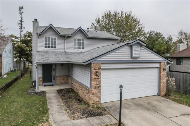 1504 Timber Village Drive, Greenwood, IN 46142 (MLS #21605958) :: Mike Price Realty Team - RE/MAX Centerstone