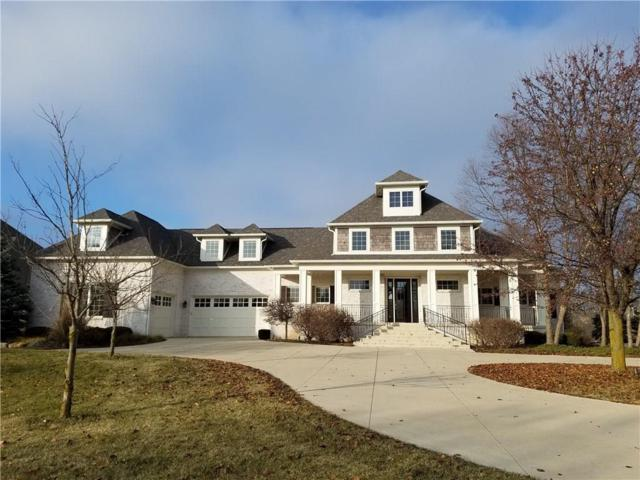 12002 Hawthorn Ridge, Fishers, IN 46037 (MLS #21610534) :: Richwine Elite Group