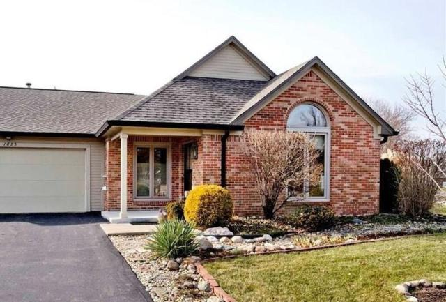 1695 Cloister Drive, Indianapolis, IN 46260 (MLS #21614605) :: The Evelo Team