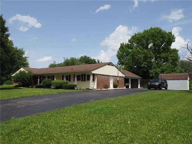 7427 Harcourt Road, Indianapolis, IN 46260 (MLS #21790007) :: Pennington Realty Team