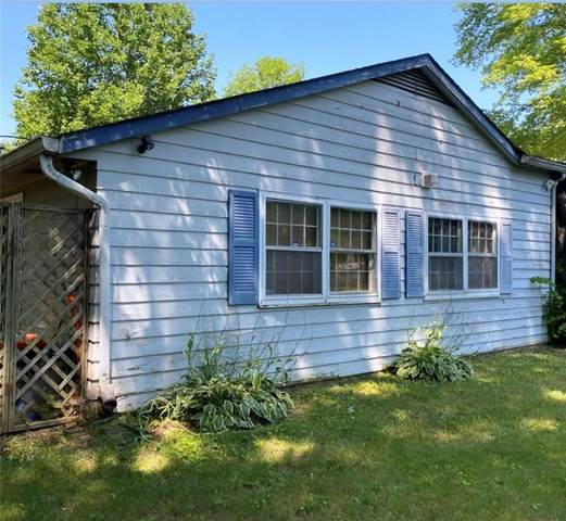 1807 W 72ND Place, Indianapolis, IN 46260 (MLS #21802436) :: David Brenton's Team