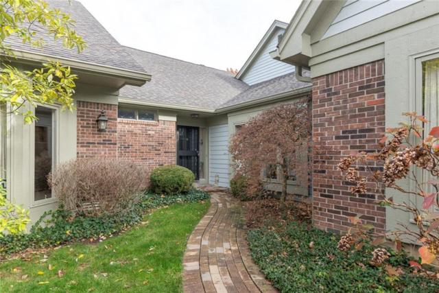 9457 Spring Forest Drive, Indianapolis, IN 46260 (MLS #21555516) :: Indy Scene Real Estate Team