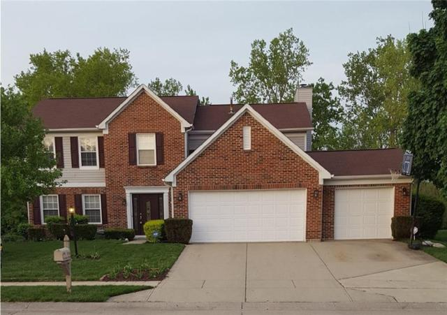 6751 Waterstone Drive, Indianapolis, IN 46268 (MLS #21565492) :: Indy Plus Realty Group- Keller Williams