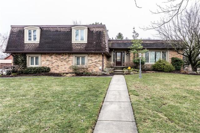 1919 Huckleberry Court, Indianapolis, IN 46260 (MLS #21616639) :: Mike Price Realty Team - RE/MAX Centerstone