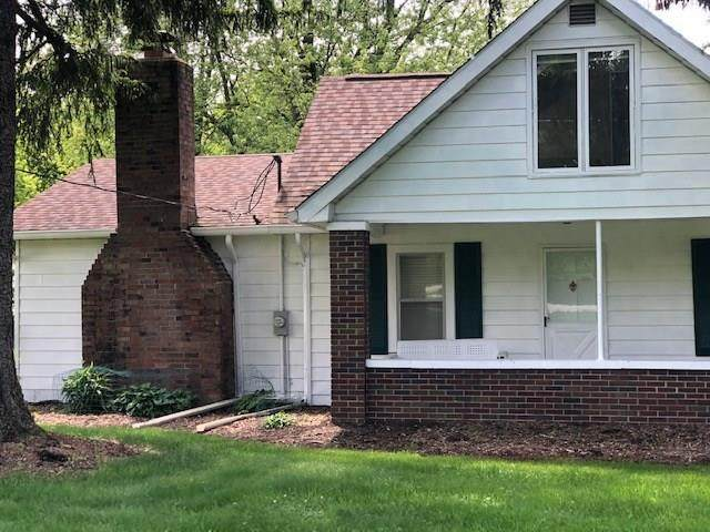 7310 N Indian Lake Road, Lawrence, IN 46236 (MLS #21714839) :: The Evelo Team