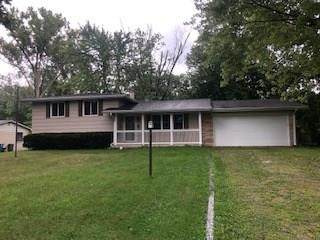 9861 Woodbriar Lane, Indianapolis, IN 46280 (MLS #21735943) :: Richwine Elite Group