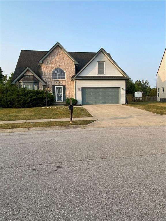 11621 Brook Crossing Lane, Indianapolis, IN 46229 (MLS #21737836) :: Anthony Robinson & AMR Real Estate Group LLC