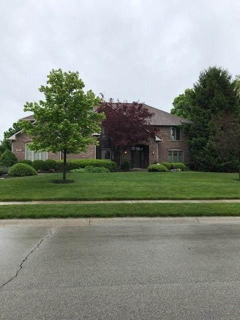 12554 Glendurgan Drive, Carmel, IN 46032 (MLS #21785655) :: HergGroup Indianapolis