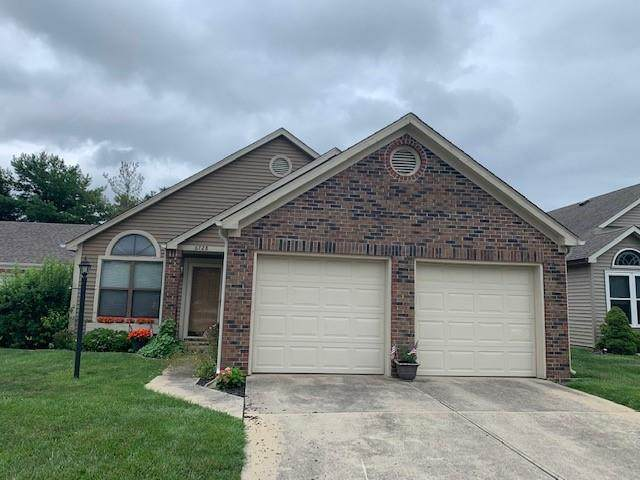 6728 Huntsman Court, Indianapolis, IN 46250 (MLS #21797553) :: Mike Price Realty Team - RE/MAX Centerstone