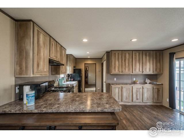 208 B St #208, Evans, CO 80620 (MLS #4522) :: Downtown Real Estate Partners