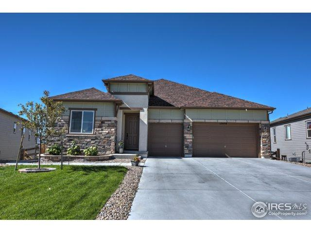 15858 W 83rd Ave, Arvada, CO 80007 (#843269) :: The Peak Properties Group