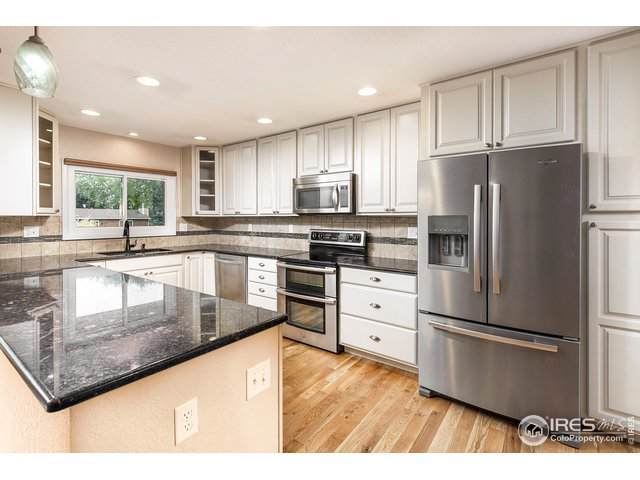 1415 44th Ave Ct, Greeley, CO 80634 (MLS #893946) :: Colorado Home Finder Realty