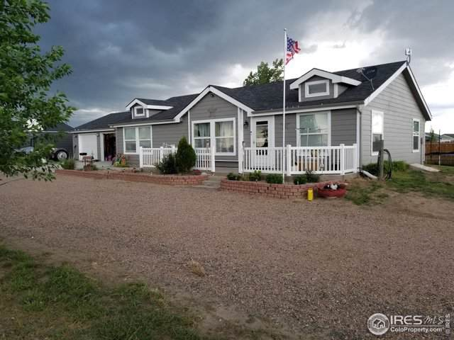4 E Ranch Rd, Wiggins, CO 80654 (#899095) :: The Peak Properties Group