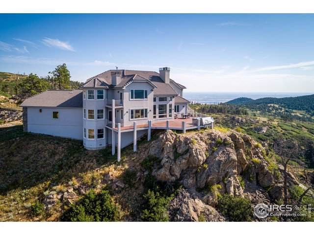 14440 Eagle Vista Dr, Littleton, CO 80127 (#899391) :: The Griffith Home Team