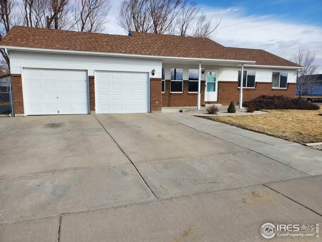 705 E Fourth Ave, Wiggins, CO 80654 (#904352) :: The Griffith Home Team